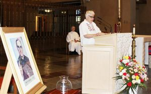 Sister Josephine Lucker, MM, who served in El Salvador from 1997 to 2004, reads from II Chronicles 24: 18-21 during the Mass.