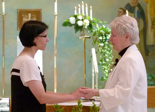 Sister Bea professes her vows to Sister Margaret Ormond, OP, prioress of the Dominican Sisters of Peace.
