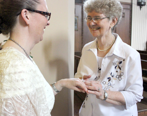 Sister Mara Rutten, left, receives her Chi-Rho ring, symbolizing her commitment to religious life with Maryknoll Sisters, from the congregation's president, Sister Antoinette Gutzler, MM.