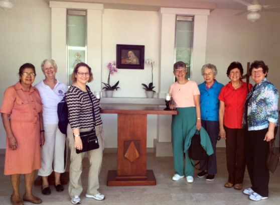 Standing around the altar are, from left, Sisters Luisa Campos,  OP, Carol Gross, OP, Lorraine Réaume, OP, Tarianne DeYonker, OP, Attracta Kelly, OP, Rosa Monique Peña, OP and Corinne Sanders, OP.