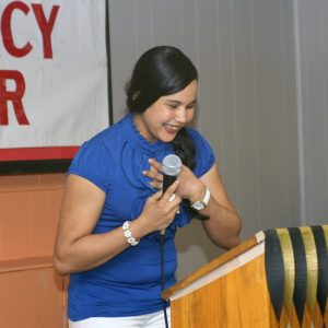 Virginia Mercado, a graduate of Aquinas Literacy Center, speaks from the heart after being awarded the Sister Claudia Hinds Scholarship.