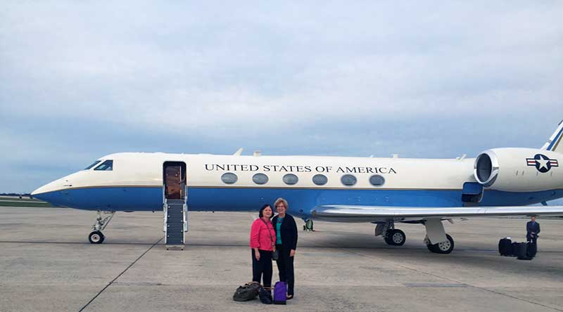 Carolyn Woo (left), President of Catholic Relief Services, and Sister Donna Markham, OP, wait to board a military jet for Rome to attend the Canonization of Mother Teresa.
