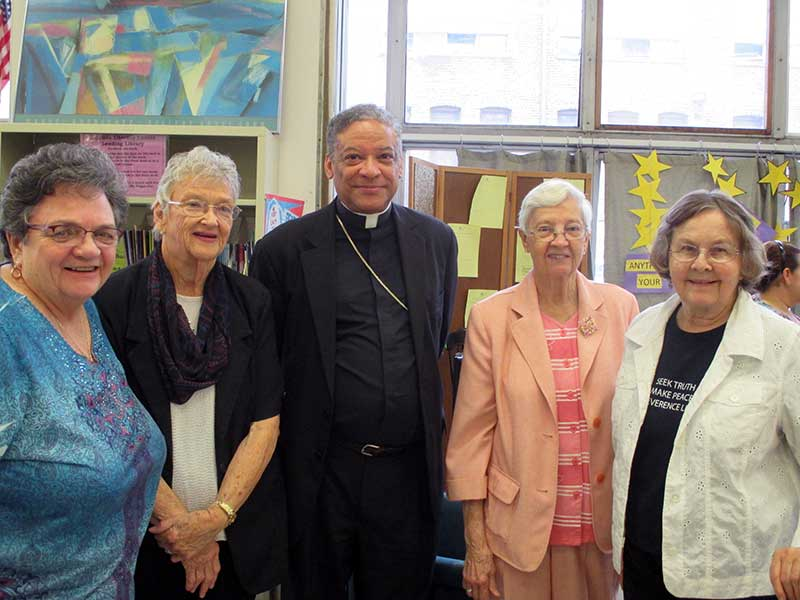 (from left to right) Mary Margaret Mannard, OP, Norine Burns, OP, Bishop Joseph N. Perry, Pat McKee, OP, and Dot Dempsey, OP