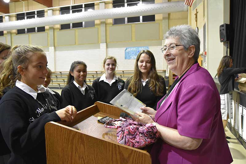 Sr. Maeve McMahon, O.P., talks with St. Mary's Dominican High School students   (from left) Rebekah Haase (River Ridge), Lily Francioni (Metairie), Hallie Cao (Metairie), Madison McDonough (Harahan) and Mia Pettitt (New Orleans) during her visit to the school. (Photo by St. Mary's Dominican High School)