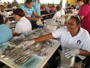 Juana Franco, Associate, helps to sterilize the instruments