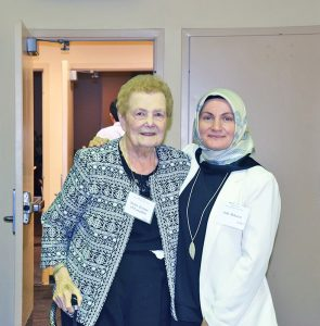 Sister Jeanne O'Laughlin, OP, left, with Asli Akkaya, faculty member of the Florida International University.