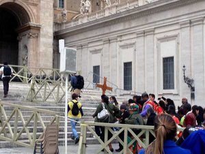 Delegates to the World Meeting of Popular Movements gathering follow the cross to one of the Doors of Mercy in Rome. (Photo by Sister Cheryl Liske, OP)