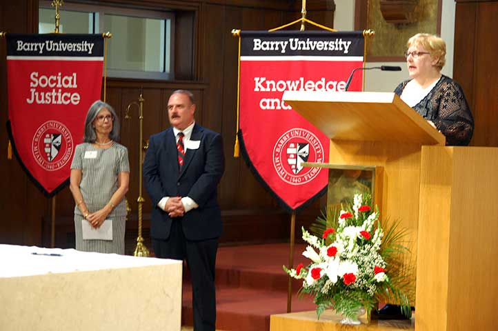 Carmen McCrink and Michael Provitera, new Adrian Dominican Associates from Barry University, listen as Mary Lach, Director of Associate Life, leads the November 14 Rite of Acceptance. (Photo by Thierry Lach)