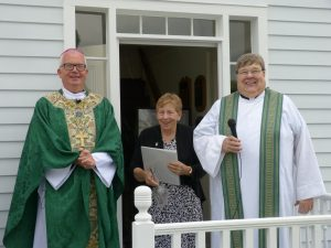 Bishop of Madison Donald J. Hying; Sister Priscilla Wood, OP; and Father Dave Flanagan stand outside the restored home of Father Samuel Mazzuchelli, OP, the day it was blessed and reopened in August 2019. Visitors are welcome to tour the home every Sunday from 2 to 4 p.m. June 7 through mid-October at St. Patrick Parish, Benton, Wis.